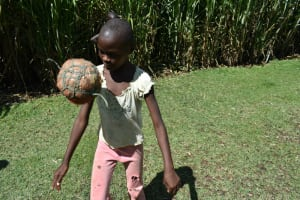 The Water Project: Malekha West Community, Soita Spring -  Child Juggling A Homemade Ball