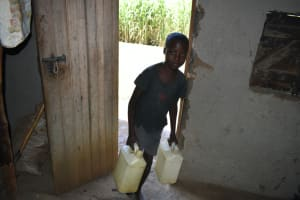 The Water Project: Malekha West Community, Soita Spring -  Arriving Home With Water