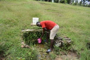 The Water Project: Luyeshe North Community, Reuben Endeche Spring -  Collecting Water