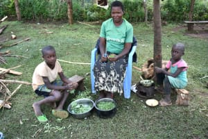The Water Project: Shihome Community, Oloo Njinuli Spring -  A Family Preparing Greens For Lunch