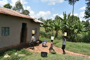 The Water Project: Shihome Community, Oloo Njinuli Spring -  Arriving Home With Water