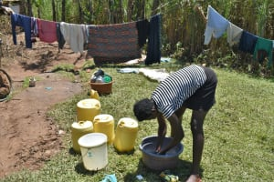 The Water Project: Shianda Community, Govet Lumbasi Spring -  Washing Clothes