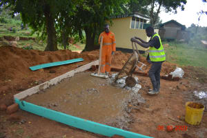 The Water Project: Makunga Secondary School -  Pouring Concrete Latrine Foundation