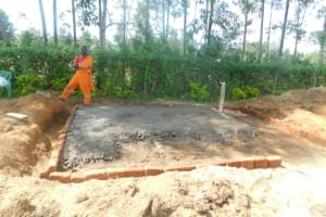 The Water Project: ACK St. Peter's Khabakaya Secondary School -  Pouring Latrine Foundation