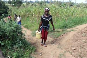 The Water Project: Makhwabuyu Community, Shirandula Spring -  Njeri Carrying Water