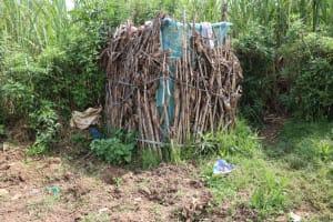 The Water Project: Makhwabuyu Community, Shirandula Spring -  Bathroom Shelter Made Of Dry Maize Stalks
