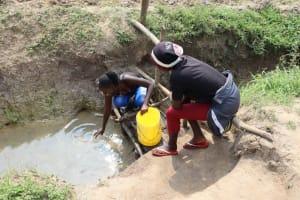 The Water Project: Makhwabuyu Community, Shirandula Spring -  Fetching Water