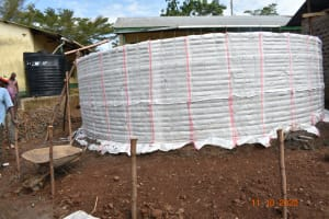 The Water Project: Makunga Secondary School -  Sugar Sacks Tied To Tank Wire