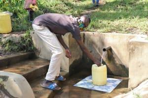 The Water Project: Bukhunyilu Community, Solomon Wangula Spring -  Kamins Fetching Water