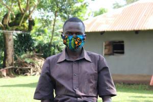 The Water Project: Bukhunyilu Community, Solomon Wangula Spring -  Kamins Wearing His Mask
