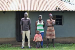 The Water Project: Bukhunyilu Community, Solomon Wangula Spring -  Kamins With Family Outside Their Home