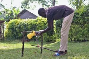The Water Project: Bukhunyilu Community, Solomon Wangula Spring -  Handwashing