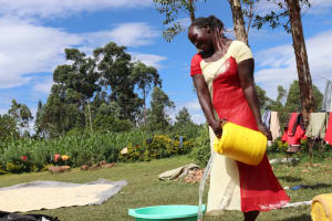 The Water Project: Emulakha Community, Alukoye Spring -  Pouring Water For Laundry