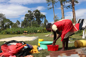 The Water Project: Emulakha Community, Alukoye Spring -  Washing Clothes Using Spring Water
