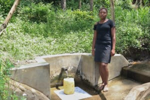 The Water Project: Emukangu Community, Okhaso Spring -  Fetching Water