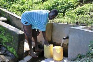 The Water Project: Eshiasuli Community, Eshiasuli Spring -  Fetching Water From Eshiasuli Spring