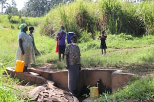 The Water Project: Shitoto Community, William Manga Spring -  Fetching Water At The Spring