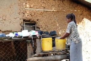 The Water Project: Shitoto Community, William Manga Spring -  Washing Utensils Using Spring Water