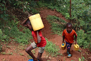 The Water Project: Shamakhokho Community, Wizula Spring -  Children Carrying Water