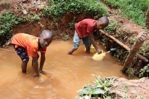 The Water Project: Shamakhokho Community, Wizula Spring -  John And Steve Fetching Water
