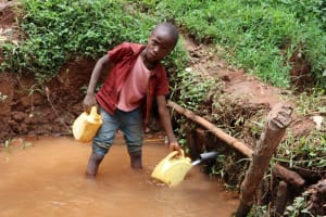The Water Project: Shamakhokho Community, Wizula Spring -  John Fetching Water