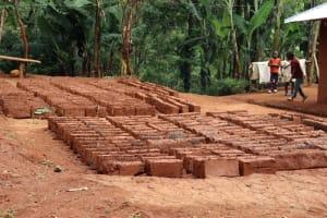 The Water Project: Shamakhokho Community, Wizula Spring -  Laying Of Bricks
