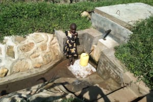 The Water Project: Eshiakhulo Community, Asman Sumba Spring -  Fetching Water From The Reservoir Tank