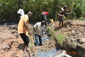The Water Project: Mahola Community, Oyula Spring -  Backfilling With Soil
