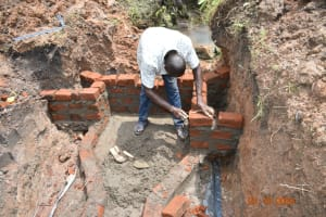 The Water Project: Mahola Community, Oyula Spring -  Brickwork Begins