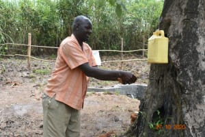 The Water Project: Mahola Community, Oyula Spring -  Committee Chair James Handwashing At The Newly Constructed Spring