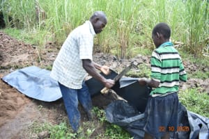 The Water Project: Mahola Community, Oyula Spring -  Cutting Tarp To Size