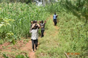 The Water Project: Mahola Community, Oyula Spring -  Delivering Stones