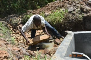 The Water Project: Mahola Community, Oyula Spring -  Every Rock Carefully Placed