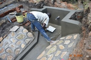 The Water Project: Mahola Community, Oyula Spring -  Fitting The Tiles