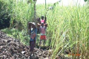 The Water Project: Mahola Community, Oyula Spring -  Kids Carrying Bricks