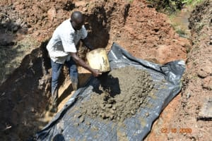 The Water Project: Mahola Community, Oyula Spring -  Laying The Foundation