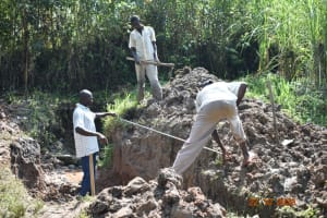 The Water Project: Mahola Community, Oyula Spring -  Measuring Excavation Progress