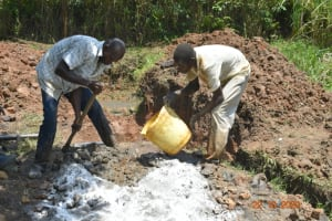 The Water Project: Mahola Community, Oyula Spring -  Mixing Concrete