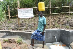 The Water Project: Mahola Community, Oyula Spring -  Mounting Is Done Much Easier As A Result Of Good Access