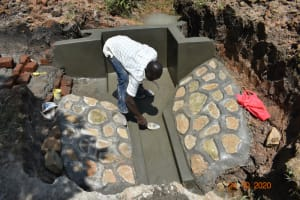 The Water Project: Mahola Community, Oyula Spring -  Plasterwork