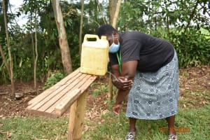 The Water Project: Mahola Community, Oyula Spring -  Trainer Emma Showing The Correct Steps Of Handwashing