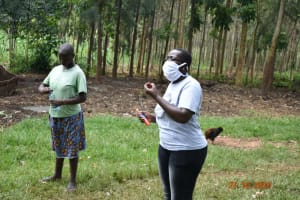 The Water Project: Mahola Community, Oyula Spring -  Trainer Jacky Leads Dental Hygiene Training