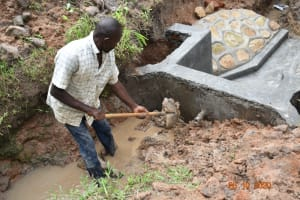 The Water Project: Mahola Community, Oyula Spring -  Backfilling With Clay