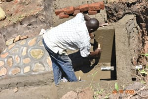 The Water Project: Mahola Community, Oyula Spring -  Cementing The Walls