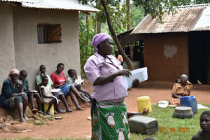 The Water Project: Mahola Community, Oyula Spring -  Community Member Participating