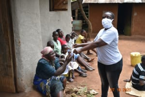 The Water Project: Mahola Community, Oyula Spring -  Distributing Masks Made During Training