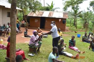 The Water Project: Mahola Community, Oyula Spring -  Distributing Masks Made At Training