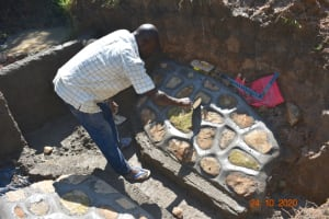 The Water Project: Mahola Community, Oyula Spring -  Plastering The Stone Pitching