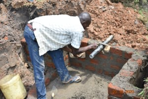 The Water Project: Mahola Community, Oyula Spring -  Setting The Pipe
