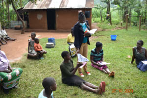 The Water Project: Mahola Community, Oyula Spring -  Sharing Posters On Covid Prevention